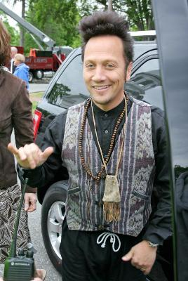 Rob Schneider give the hang loose sign to fans in Boston